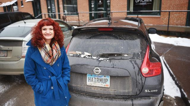 "Angelique Verver talks about her license plate that reads ""HAIRMUP"" Thursday, Feb. 8, in front of Platinum Imagination Hair and Makeup in downtown Sioux Falls."