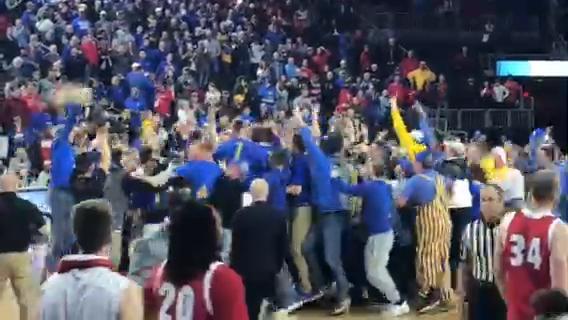 SDSU fans storm court after men beat USD