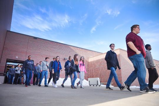 Students at Roosevelt High School walk out of class Wednesday, March 14, in response to the Parkland, Florida shooting.
