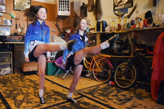 Rylie Brison, left, and Grace Swain, right, practice Irish dancing in Rylie's garage Tuesday, March 13, at her home in Sioux Falls. Brison and Swain are going to Glasgow, Scotland for World Irish Dancing Championships, which starts March 24.