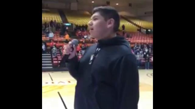 Former Red Cloud student Steven Wilson sings the Star Spangled Banner in the Lakota language for the Class A State Basketball tournament in Rapid City on Friday, March 16. Courtesy Kevin phillips.