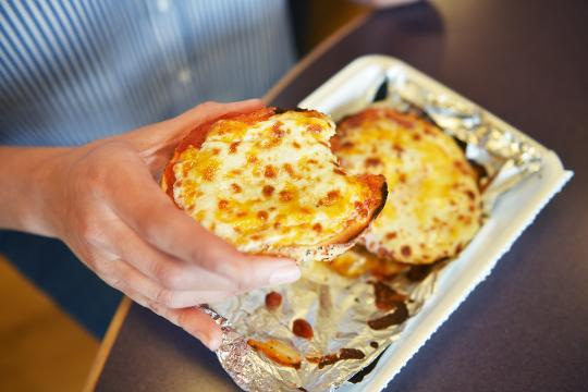 Bagel Boy owner Mike Dinsmore makes a pizza bagel Thursday, May 17, at the Minnesota Avenue location in Sioux Falls. Dinsmore said they have sold 1,600 pizza bagels at that location alone.