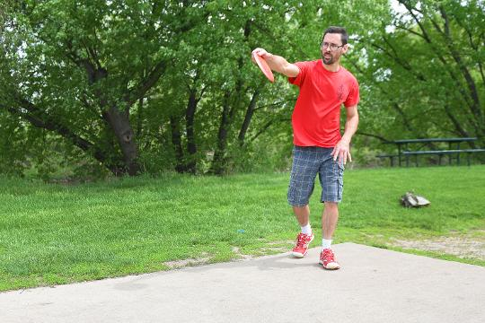 Brad Walker plays disk golf at Tuthill Park Friday, May 18, in Sioux Falls.