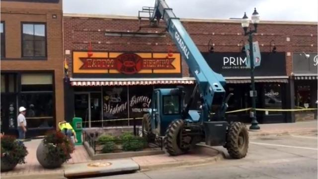 Crews were working to shore up the facade of a downtown Sioux Falls building after it started to peel off Thursday.