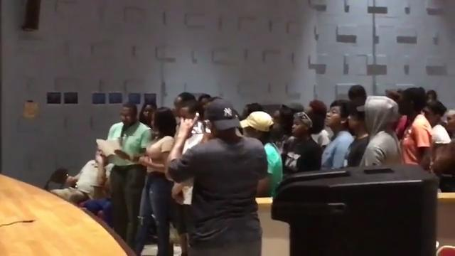 Dozens of Upward Bound supporters, along with former board president/program coordinator Ralph Coates,attended Wednesday's meeting to speak out against removing the office.