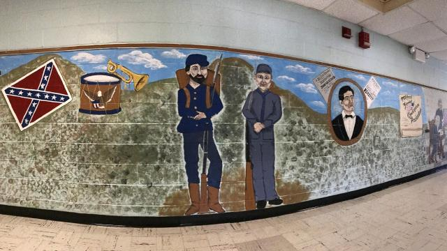 The Wappingers Central School District is contemplating the future of an elementary school mural that depicts scenes from the Civil War, including a Confederate battle flag.