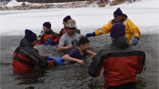 Groups of people jumped into the frozen lake in Highland as part of Subzero Heroes. Before the event, they had helped raise around $100,000 for the Alzheimer's Association. Video by Jack Howland/Poughkeepsie Journal