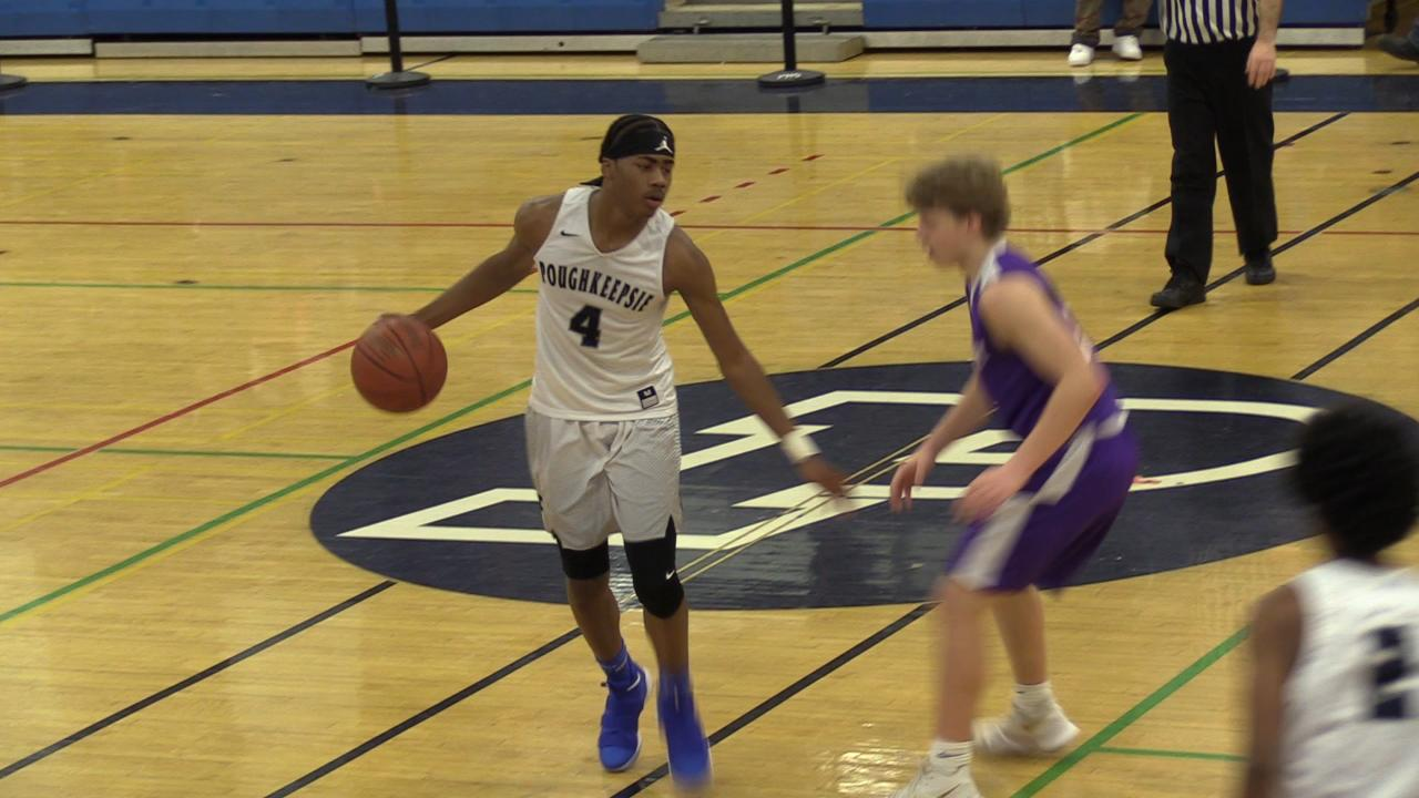 Poughkeepsie High School boys basketball tops John Jay Cross River 80-67 in Friday night's game.
