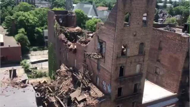 Crews were in the City of Poughkeepsie preparing Tuesday to demolition 19 Academy St., which collapsed on Monday.