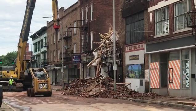 Crews continue to work on scene to secure the surrounding area of the building at 19 Academy Street on Wednesday, June 20. The building partially collapsed on Monday.
