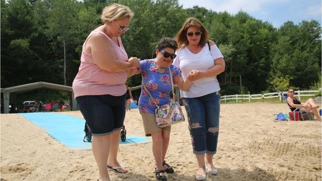 Adults and children with special needs came to East Fishkill's A Day at the Beach at Red Wing Lake Park, which has inclusive elements like a pathway on the sand. It's a part of Dutchess County's ThinkDIFFERENTLY initiative aimed at increasing inclusivity. Video by Jack Howland/Poughkeepsie Journal