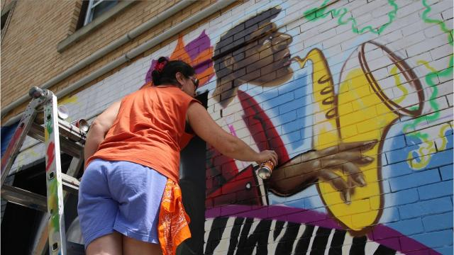 The O+ festival brought murals to the City of Poughkeepsie this weekend along with live music and activities. Participating artists were paid in health and wellness care as opposed to money. Video by Jack Howland/Poughkeepsie Journal