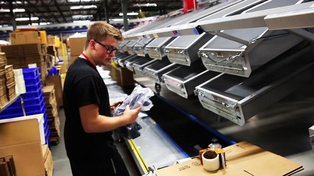 Fulfillment centers are handling even more business as plenty of people turn to online retail for their shopping needs. Here's a look at a facility ran by Radial, which counts Neiman Marcus, Guess, GameStop and Bath & Body Works among its clients.