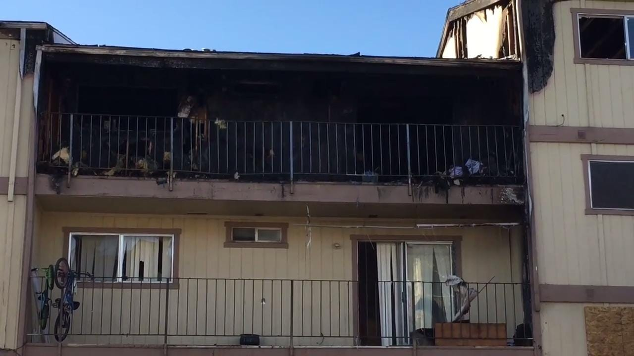 Neighbors describe seeing the fire engulf a section of the Stardust Apartments in Reno on Dec. 14, 2017. The building was left vacant as crews worked to board up the units in the aftermath of fire.