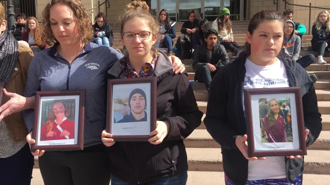 Students at UNR gathered Wednesday, March 14, 2018 to pay tribute to the victims of the Parkland, Fla., school shooting.