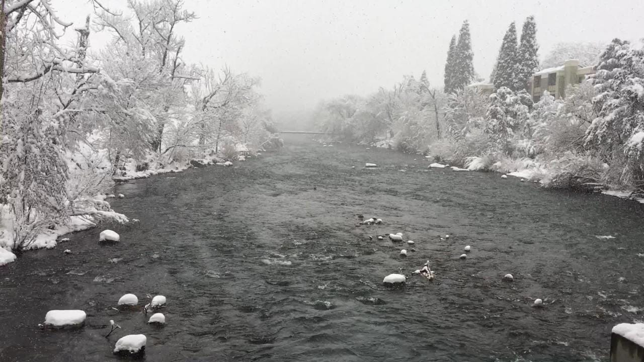 Snow falls on the Truckee River on Friday morning March 16, 2018.