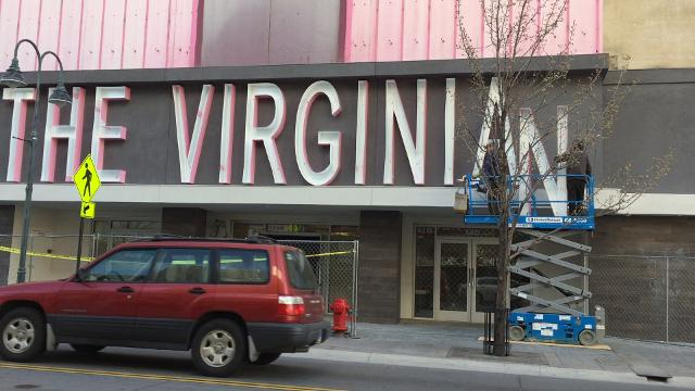 Workers install a new sign on the Virginian in downtown Reno on Friday, March 30, 2018.