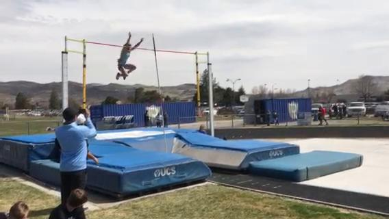Reed senior Alysia Allen clears 12-0 in the pole vault Saturday at the Reed Rotary track and field meet.