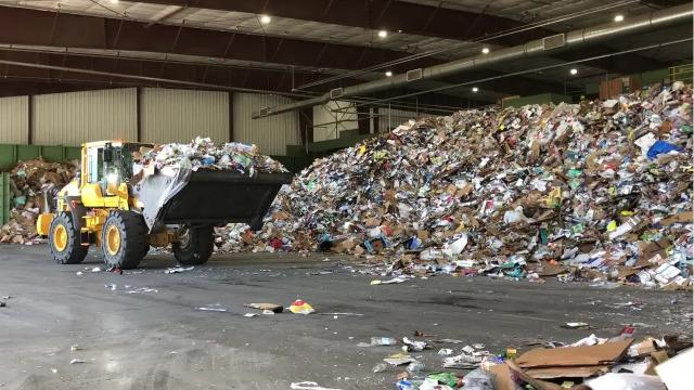 Recycle bins are sometimes being filled with trash or other weird objects, causing slow downs and problems for the Waste Management recycling facility.