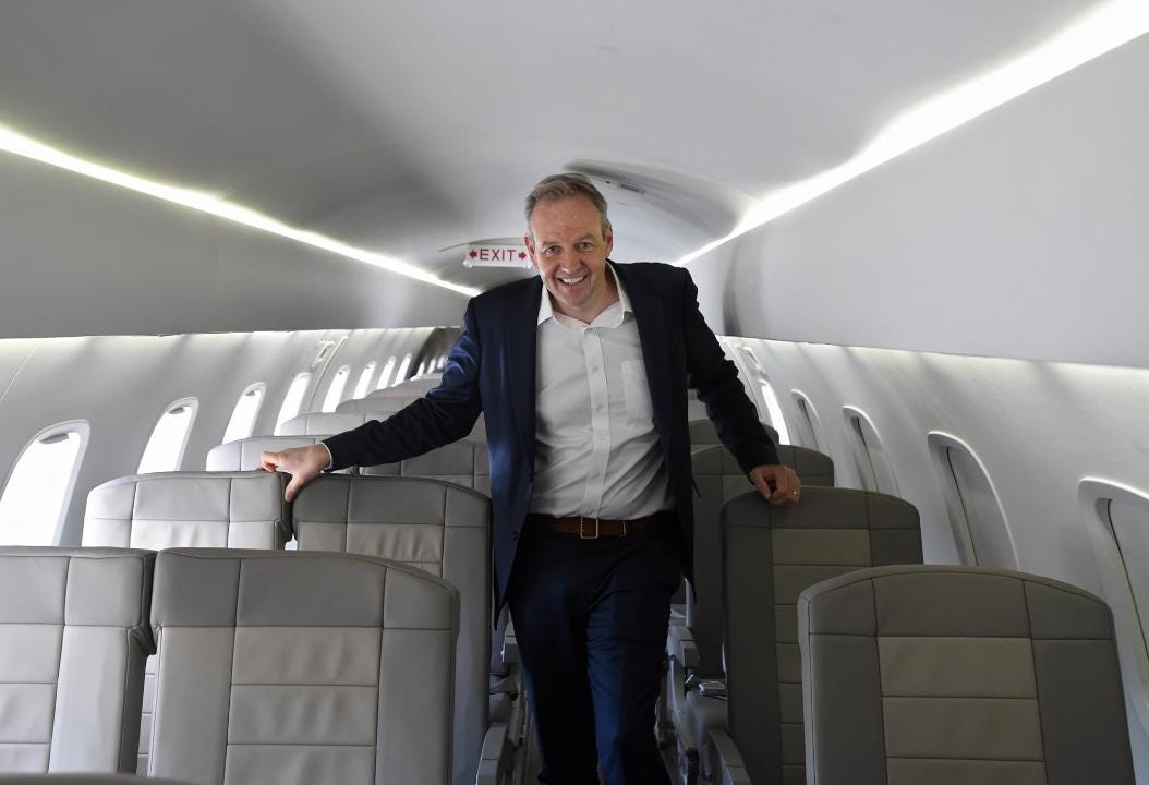 JetSuiteX CEO Alex Wilcox shows the insides of one of the company's Embraer ERJ135 planes during a stop in Reno.