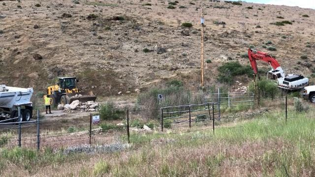 Crews work to repair Washoe Lake Dam on Monday, June 18, 2018.
