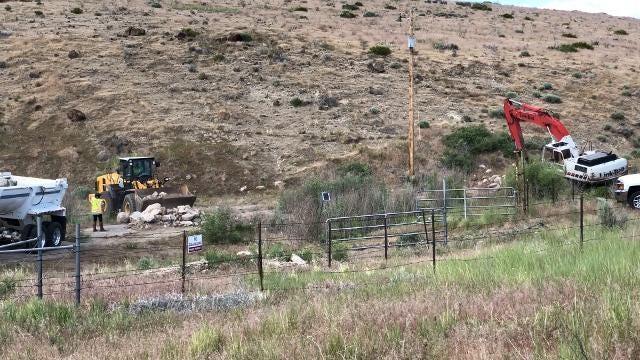 Crews work to repair Washoe Lake Dam on Monday, June 18, 2018.