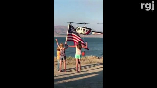 Echo and Andy Mathews took this dramatic video of a copter pilot scooping water from Pyramid Lake to fight the Perry Fire. The fire burned 51,400 acres from July 27 to Aug. 6; at least three homes were damaged or destroyed.