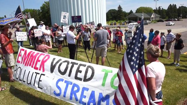 Protesters demand town hall meeting