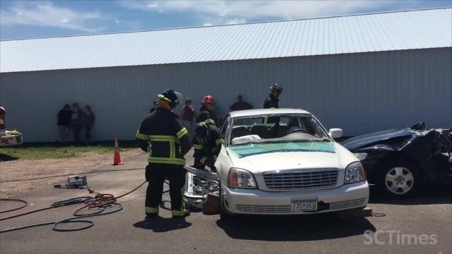 Fire crew cuts apart car