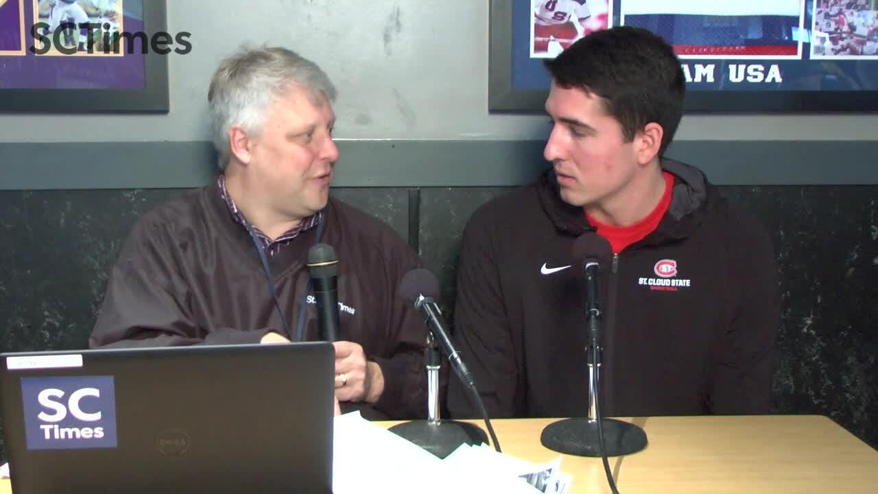 Jon Averkamp talks with Mick Hatten at SCSU Sports Chat at Buffalo Wild Wings.