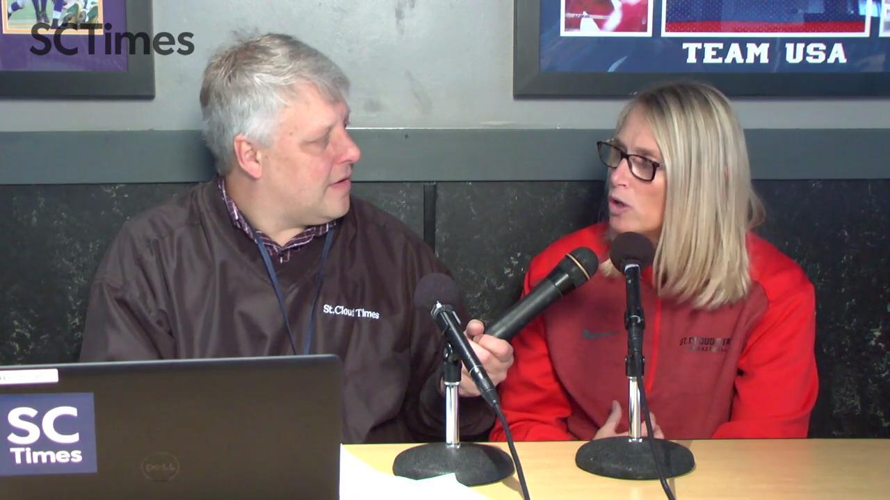 Lori Fish talks with Mick Hatten at SCSU Sports Chat at Buffalo Wild Wings.
