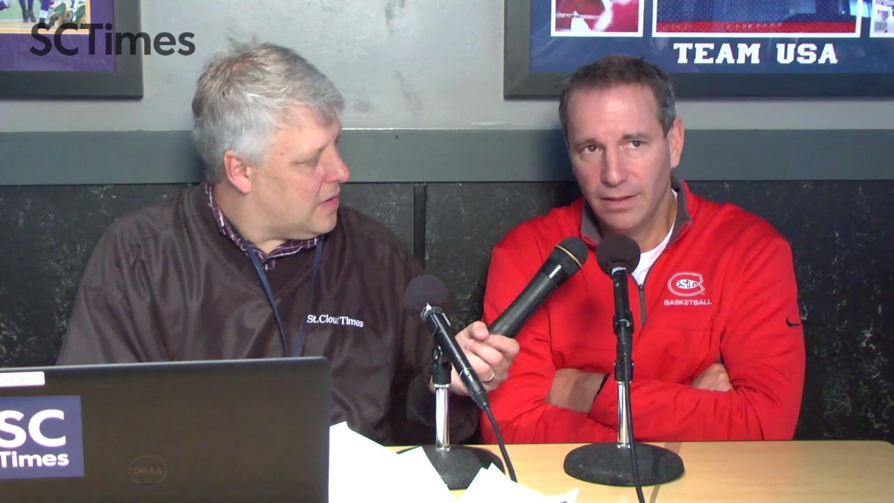 Matt Reimer talks with Mick Hatten at SCSU Sports Chat at Buffalo Wild Wings.