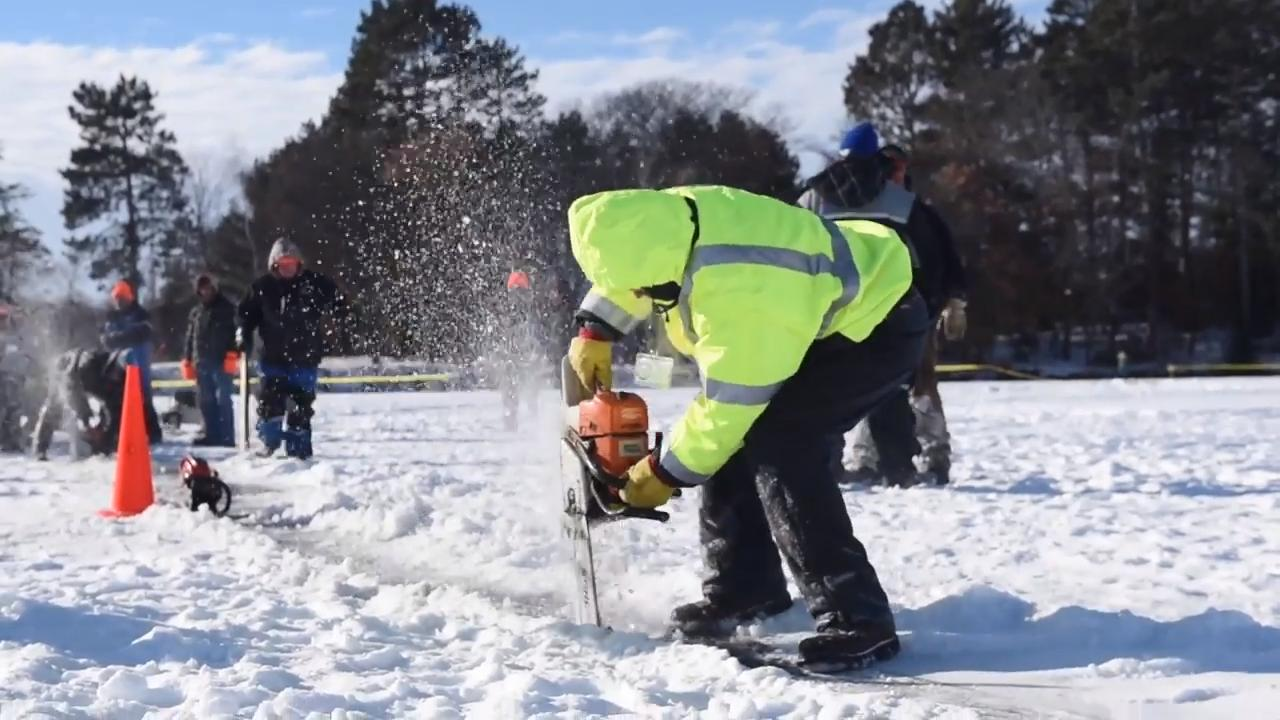Volunteers attempt to create a spinning ice carousel.