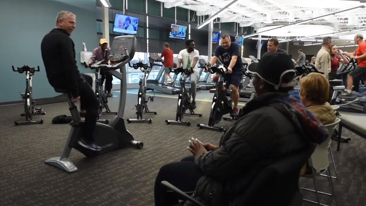 Mayor Dave Kleis holds his Town Hall meeting while riding exercise bikes at the YMCA.