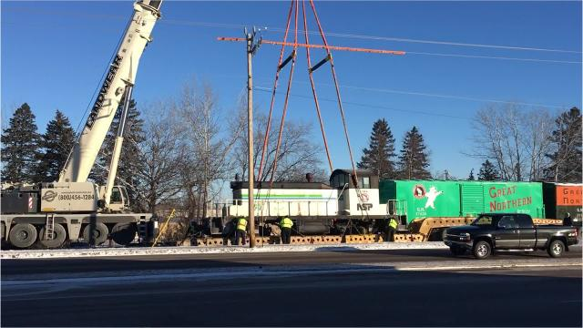 On a frigid morning, on Saturday, Jan. 13, a crew used a crane to lift the 99-ton diesel locomotive from a trailer to its new permanent home. The locomotive joins two boxcars and red caboose already on display by St. Cloud Area Rail Legacy Museum, or STARail.