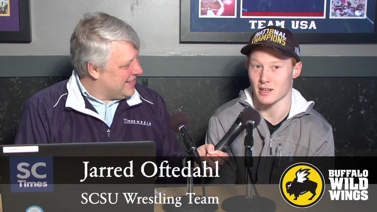 Mick Hatten talks St. Cloud State wrestling with assistant coach Brady Wilson and senior wrestler Jarred Oftedahl during this week's SCSU Sports Chat at Buffalo Wild Wings in St. Cloud.