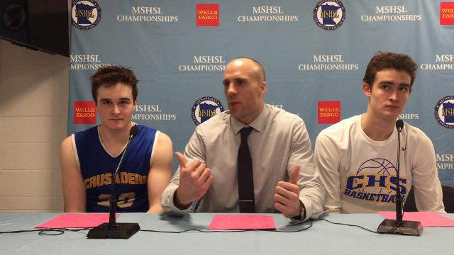 St. Cloud Cathedral's (from left) Michael Schaefer, Matt Meyer and Mitch Plombon discuss their 77-51 loss to Minnehaha Academy.