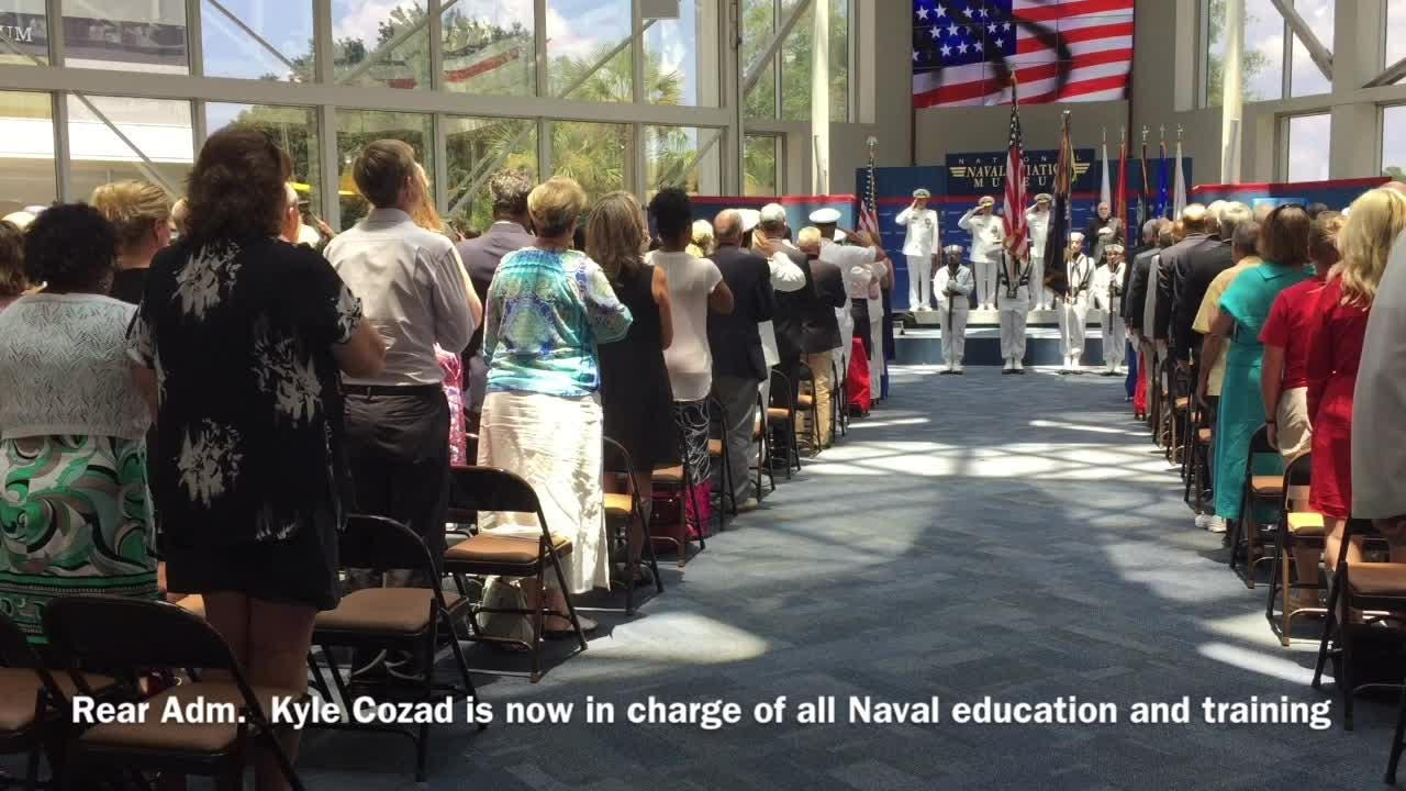 Rear Adm. Kyle J. Cozad took the helm of the Naval Education and Training Command during a ceremony Thursday, July 20, 2017, at the National Naval Aviation Museum.