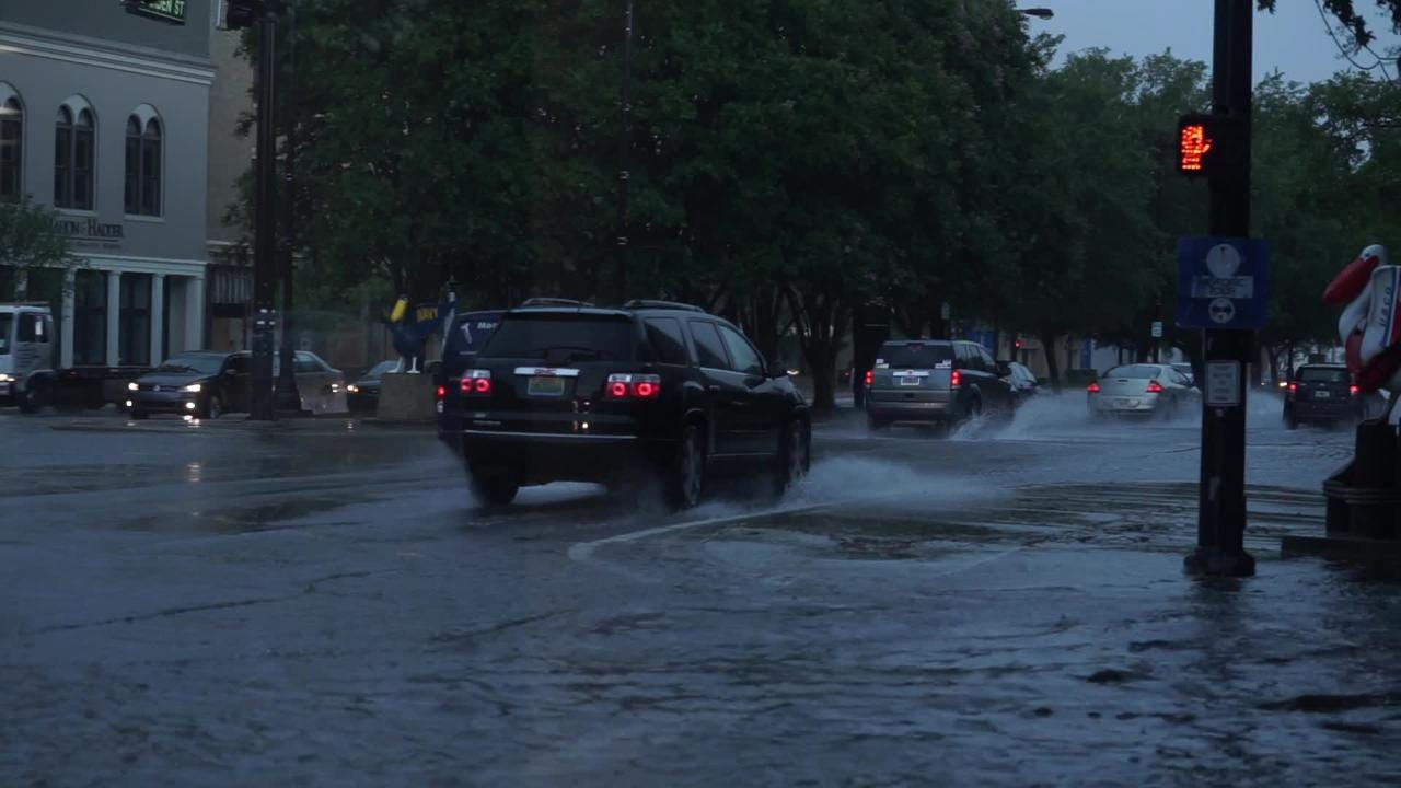 The intersection of Palafox and Garden streets flood after heavy afternoon thunderstorms.