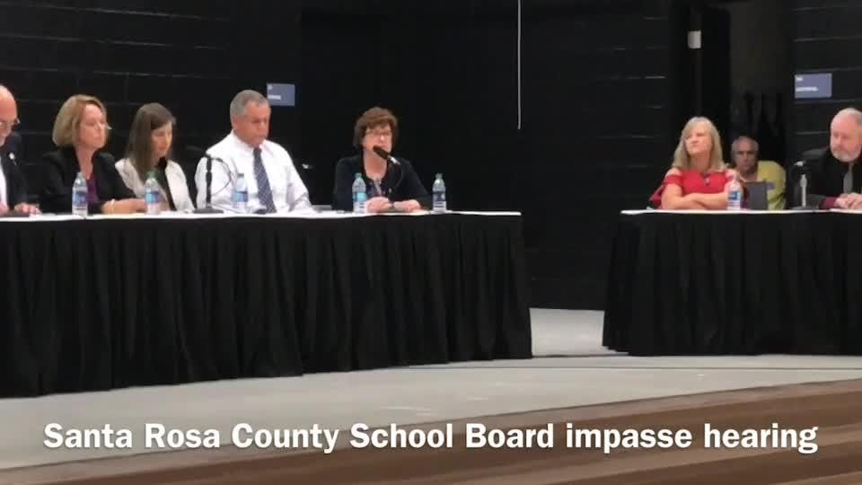 The Santa Rosa County School Board took the side of the school district in its protracted dispute with a teachers' union over salary increases during a public meeting on Thursday, Aug. 10, 2017, at Bennett C. Russell Elementary School in Milton.