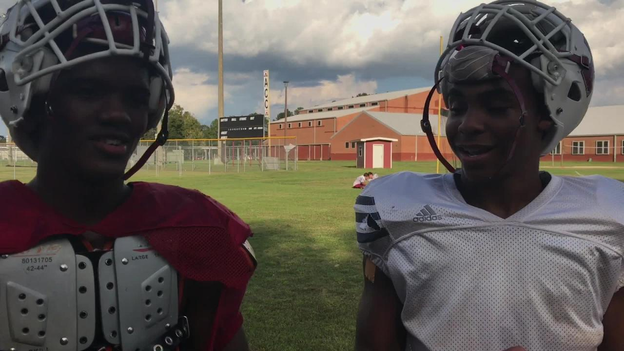 Tate's Jaderian Johnson and Shermari Jones have a few laughs before Friday's big game at Escambia.