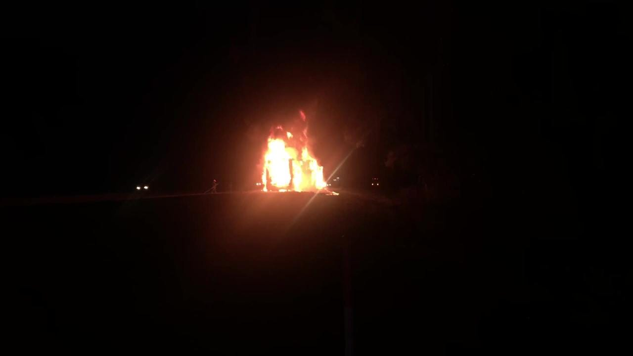 A bus carrying Navarre High School students caught fire after they were returning home from an away football game in St. Augustine. (Credit: Dean Barrow)
