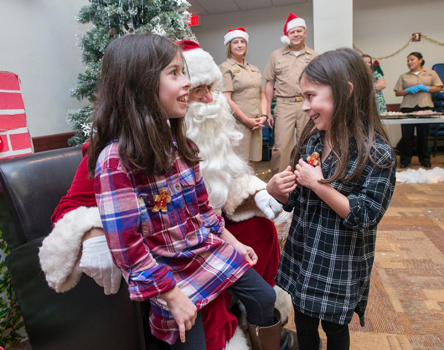 Santa arrived at the Naval Hospital in Pensacola escorted by a police car and string of reindeer clad bikers on Friday, Dec. 1, 2017.  Children, staff, & visitors enjoyed meeting the big man in red during the hospital's annual holiday celebration.