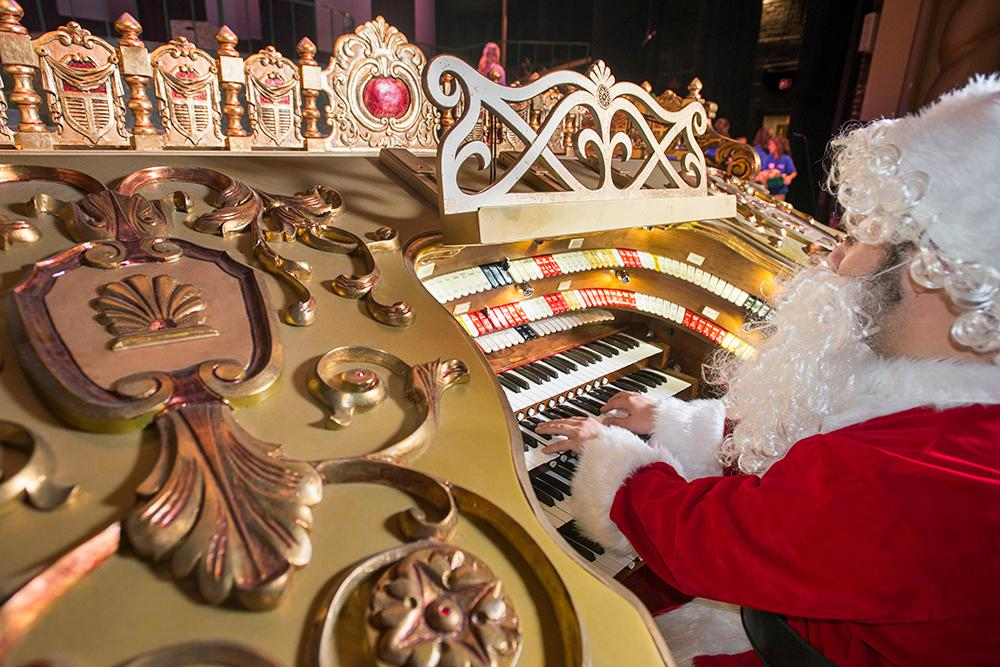 Pensacola Children's Chorus artistic director Alex Gartner demonstrates the newly refurbished vintage Robert Morton organ at the Saenger Theatre during the Pensacola Children's Chorus rehearsal.