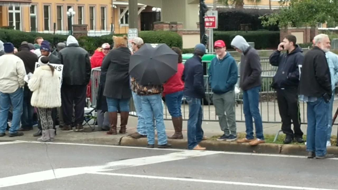 People already begin lining up for Trump rally in the midst of light rain.