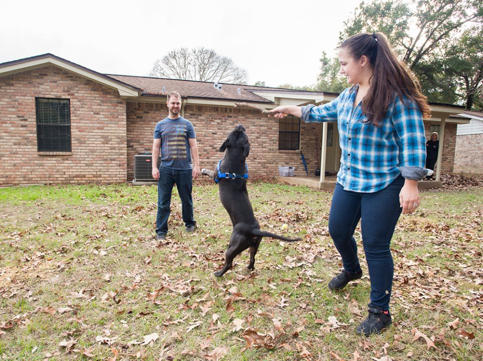 New homeowners Austin and Michelle Lewis settle into their house in Pensacola as real estate agent Carrie Firth explains that the housing market is good for both sellers and buyers in Escambia County.