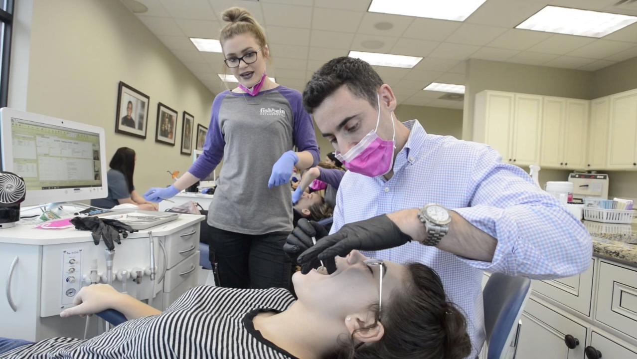 """Dr. Ben Fishbein & his Pensacola area Fishbein Orthodontics is helping with the fight against bullying by giving away free braces to winners of a """"share your bully experience"""" essay contest. The essay or video submission deadline is January 29, 2018."""