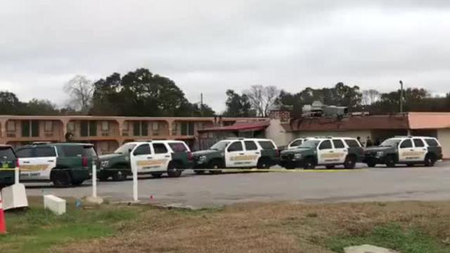 Police are responding to a hotel on Nine Mile Road where authorities say a man with a firearm has barricaded himself in a room and refused to come out.