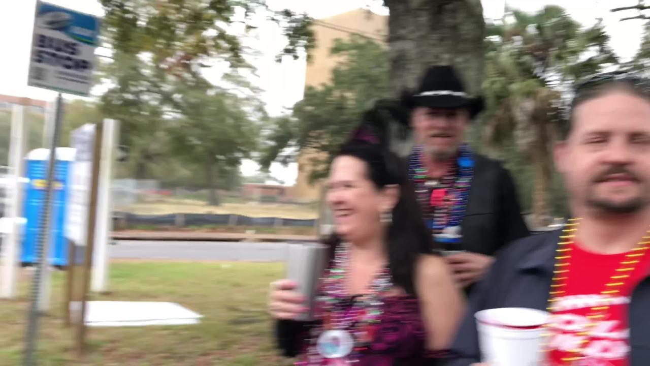 Couple gets married on Krewe of Blues Mardi Gras float before parade.