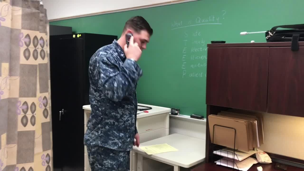 A Navy corpsman discusses his work at a busy Naval Air Station Pensacola clinic for students.